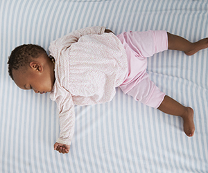 African American baby sleeping safely