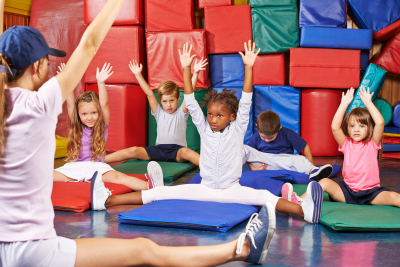 Children in gym stretching