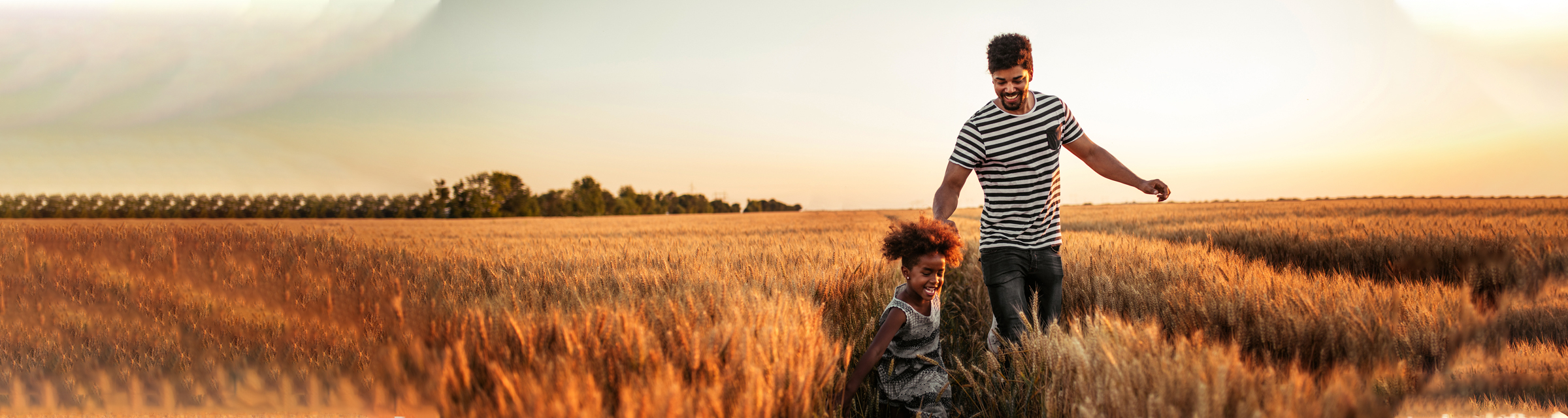 Father and daughter in field